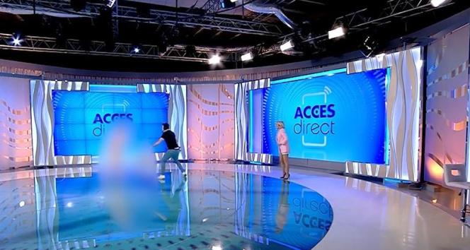 Romanya'da çıplak bir kadın canlı yayında sunucuya saldırdı